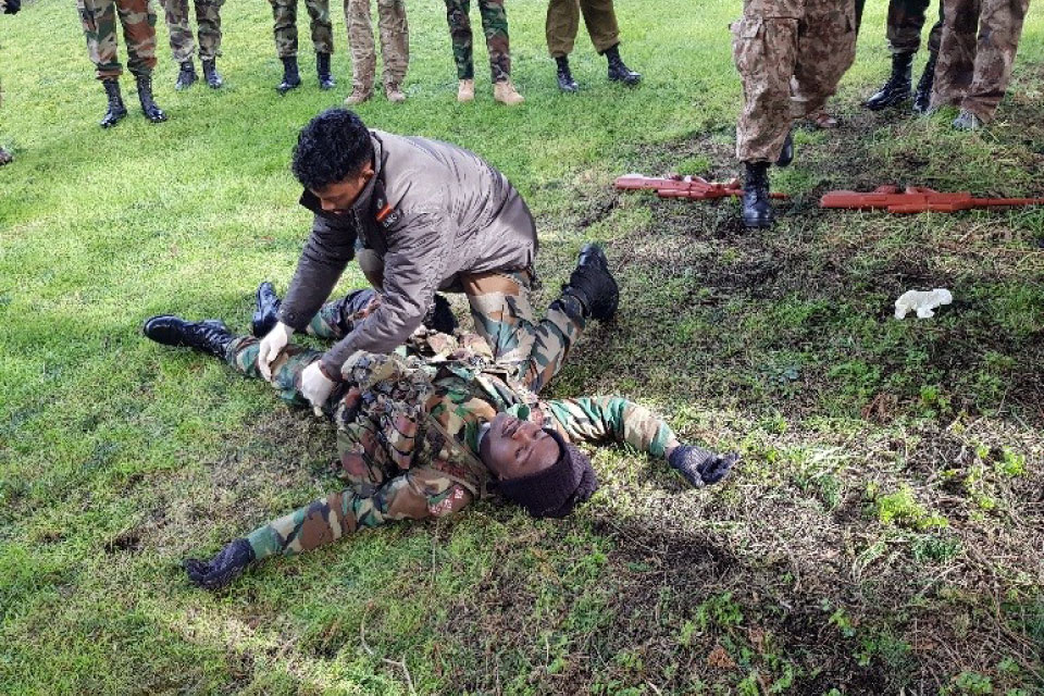 Captain Boateng (Ghana) as the casualty with WO Prakash (India).