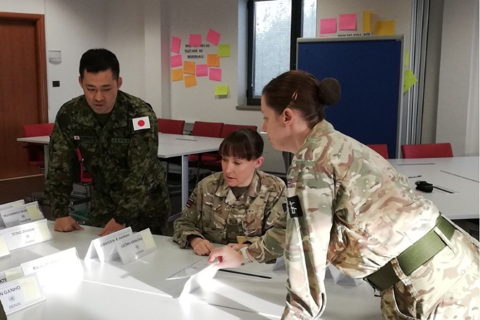Lt Col Kawano (Japan), SSgt Slane (UK) and Sgt James (UK) plan assessment groups