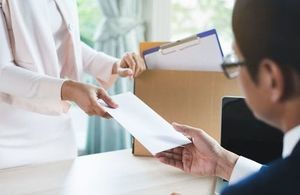 Man being given a redundancy letter