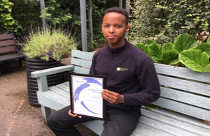 Ahmed Yusuf holding his certificate which names him Professional Young Engineer of the Year by the Pump Centre