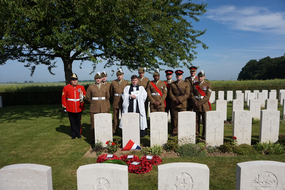 The military party gather at the graveside of Cpl Davies, Crown Copyright, All rights reserved