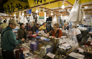 Customer makes purchase at fishmonger stall