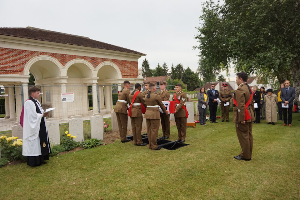 The burial party from 1st Battalion The Royal Welsh lay the unknown South Wales Borderer to rest in Bethune Town Cemetery, Crown Copyright, All rights reserved
