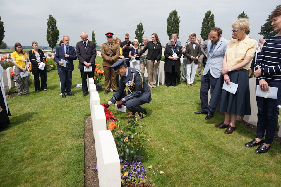 Group Capt Justin Fowler, Defence Attache Belgium and Luxembourg, lays a wreath at Capt Kington's grave in Tyne Cot Cemetery, Crown Copyright, All rights reserved