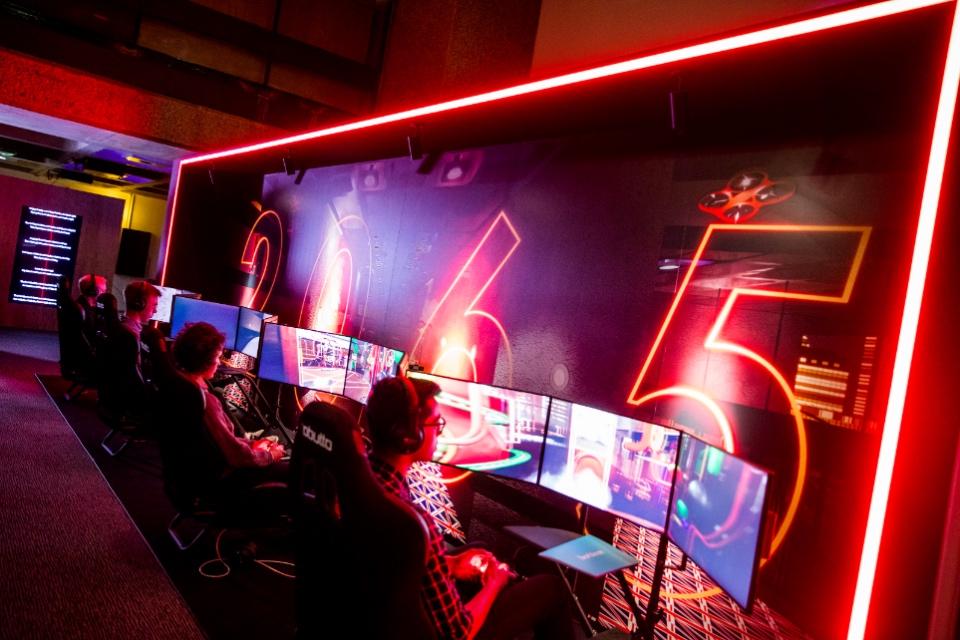 People looking a number of screens