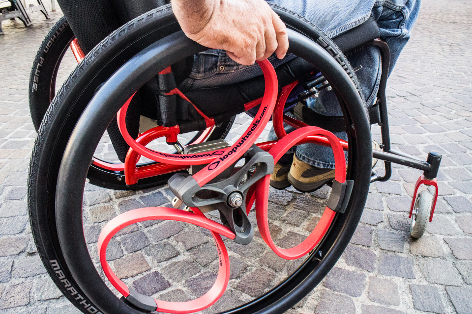A close-up of a Loopwheels wheelchair wheel.