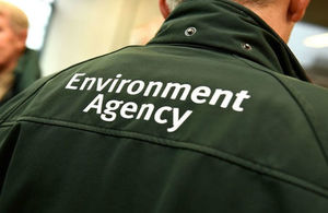Closeup of the logo on the back of an Environment Agency officer 's uniform