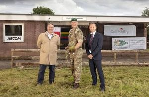 Standing in the image are Mark Wusthoff Area Director for Galliford Try South West, Col M J Tanner OBE, and Simon Jones DIO Project Manager.