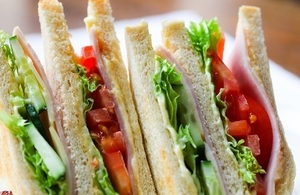 A picture of several sandwiches with lettuce, tomato and meat.