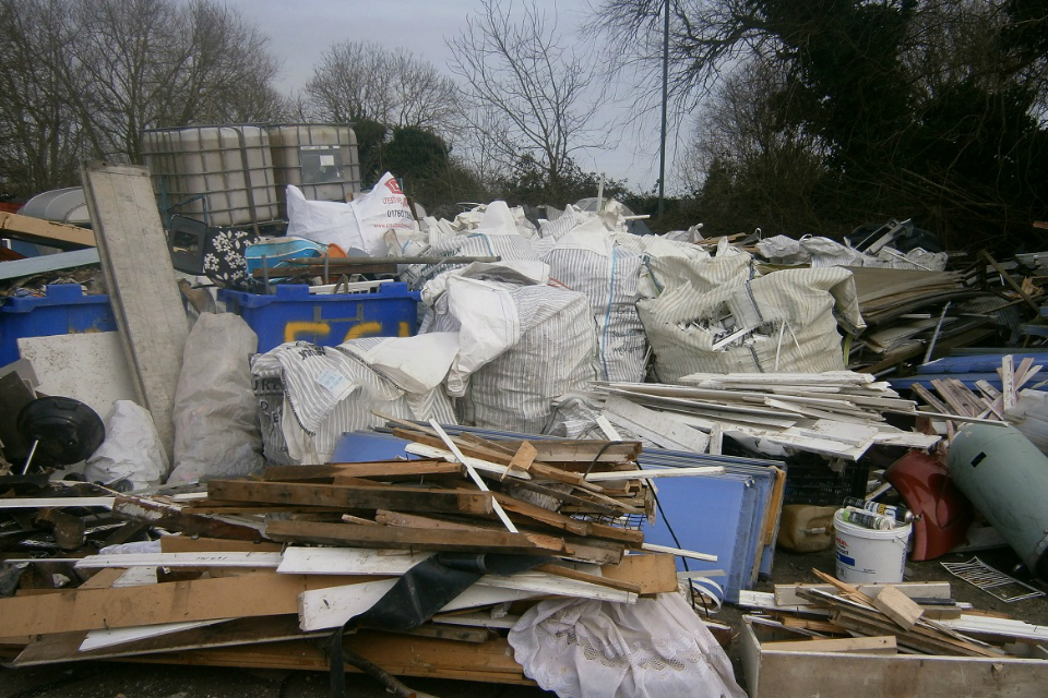 Piles of waste which were illegally stored at Fairfield Garage in Hilgay, Norfolk