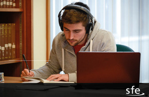 image of student using laptop