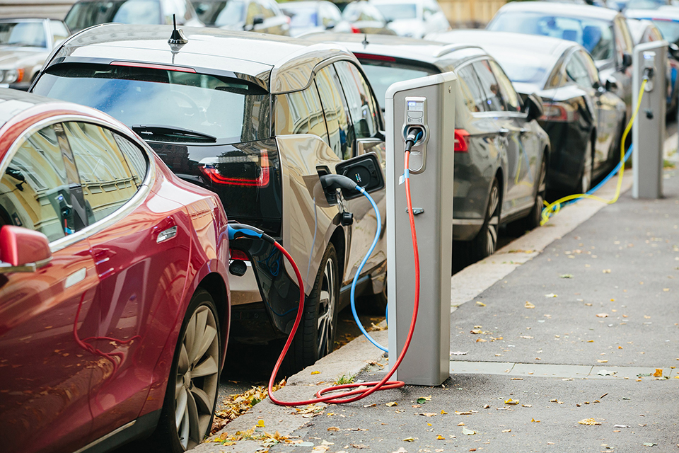 Electric vehicles being charged on the road using electric vehicle chargepoints