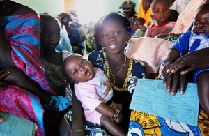 Image of families receiving testing and counselling for HIV in the Gambia through the Global Fund