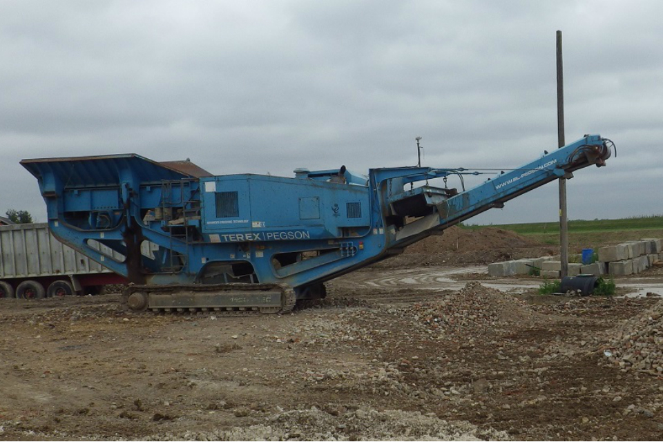 Heavy crushing machinary on farm in Hertfordshire