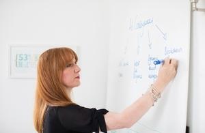 Woman using whiteboard