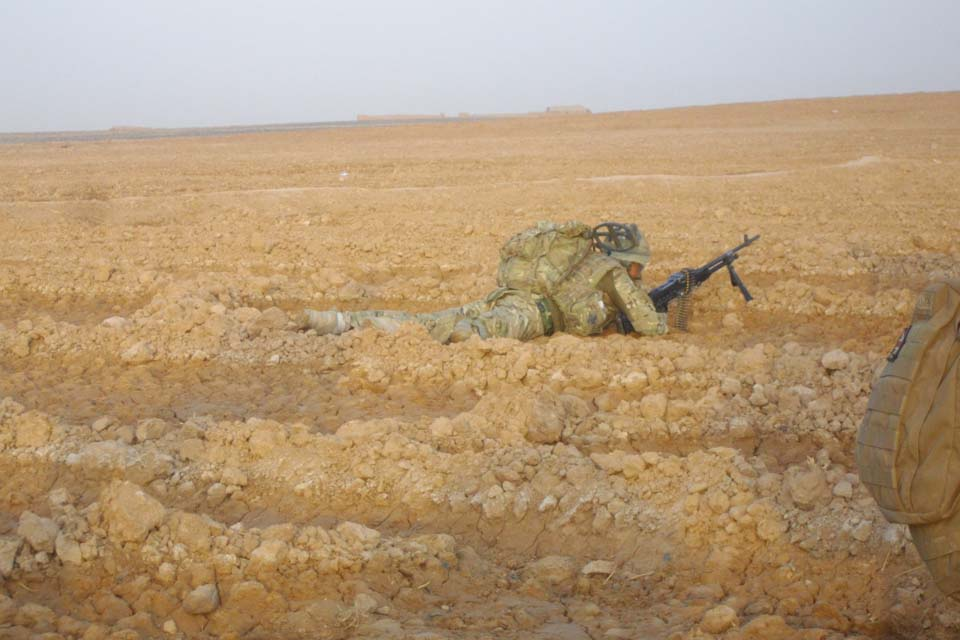 A British soldier takes cover