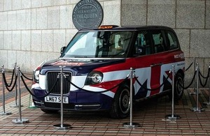 Electric taxi with union jack markings on display at a zero emissions vehicle summit.