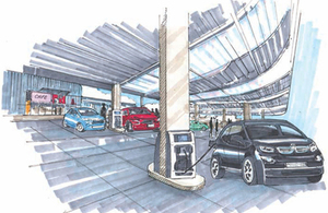 Artist impression of an electric chargepoint forecourt, with electric vehicles parked at charge points