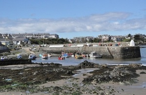 Anglesey: view of the harbour with boats and houses in the background
