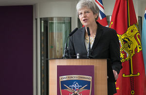 Prime Minister, Theresa May, stood behind a podium in Northwood Headquarters.