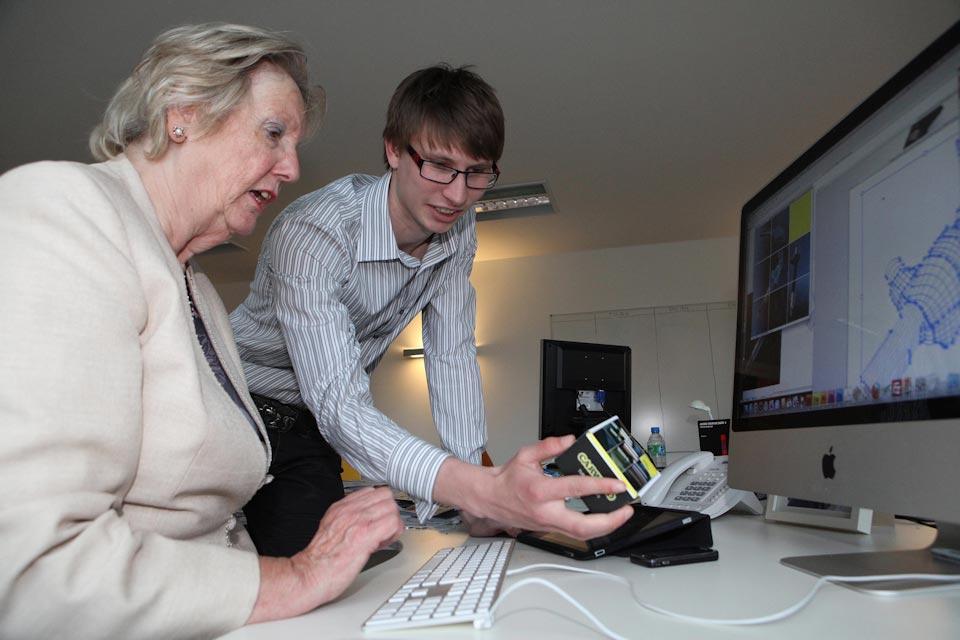 Baroness Hanham in front of a computer