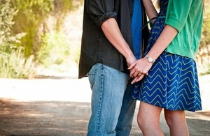 Image of couple holding hands