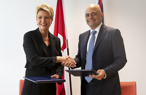 Home Secretary Sajid Javid and Swiss Federal Councillor Karin Keller-Sutter shake hands after signing an agreement to continue cooperation on internal security post-Brexit.