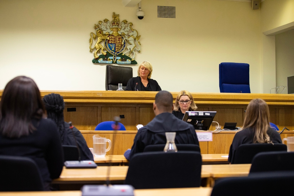photograph of court room with judge and courts users
