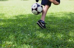 A child kicking a football