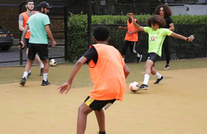 Footballers at a Queen's Park Premier League Kicks coaching session