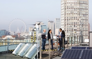 Researchers examine the energy tech on the roof of the K2 building, South Bank University, London