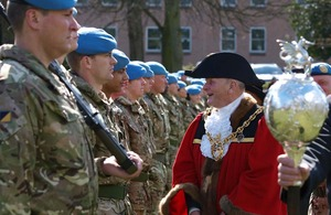 Wrexham's Lord Mayor greets soldiers outside the town's Guildhall