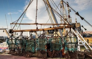 scallop dredge hanging in harbour
