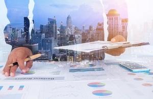 Businessmen Examine Finance Tax