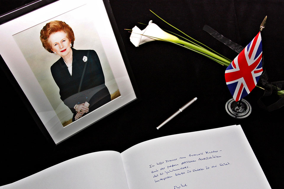 Chancellor Merkel signs the condolence book