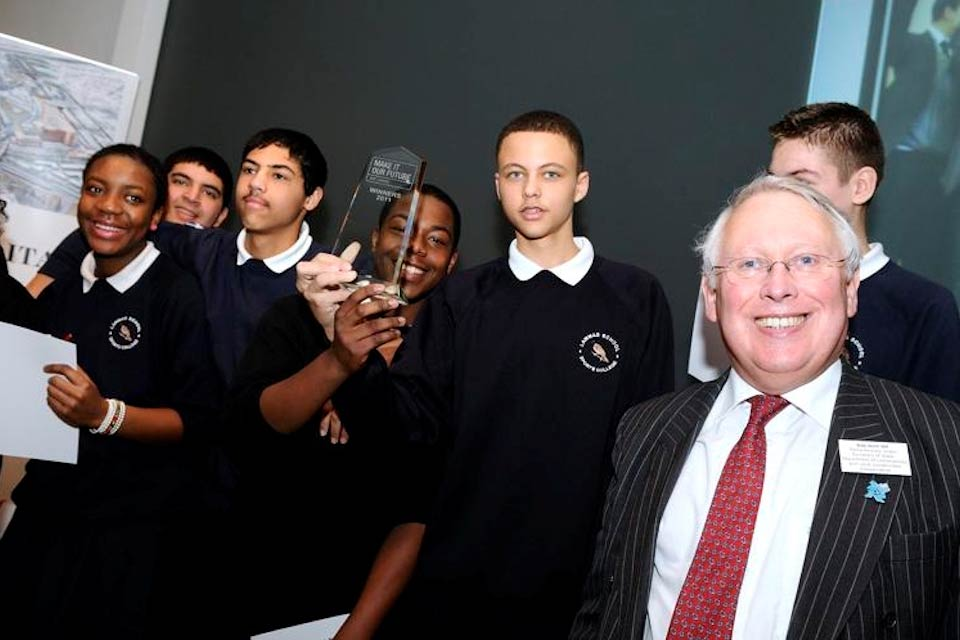 Bob Neill with school children