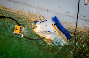 Robotic cleaner being tested ready to clean the walls of a nuclear storage pond