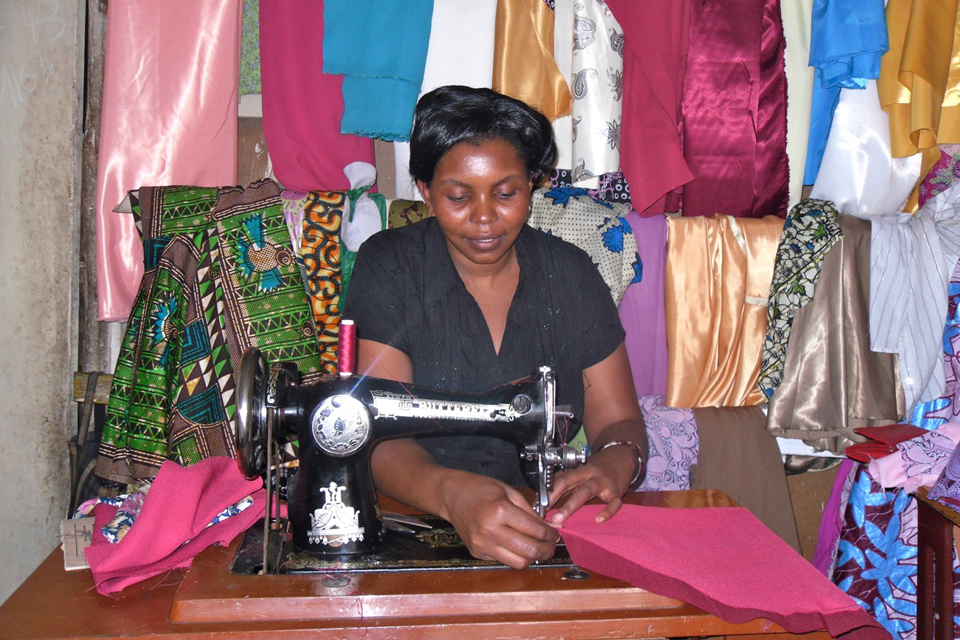 Vick Makundi, at work in her tailor shop. Picture: AFCAP/Crown Agents