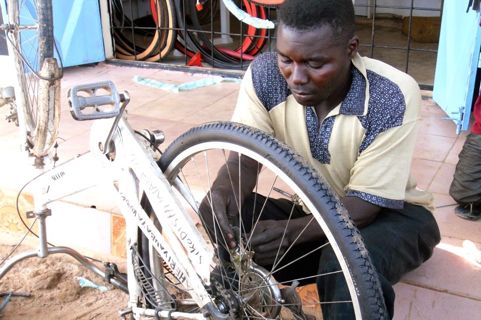 Imani Ali at work in his bike shop. Picture: AFCAP/Crown Agents