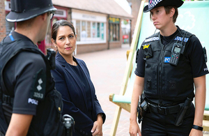 Home Secretary Priti Patel with officers from Essex Police