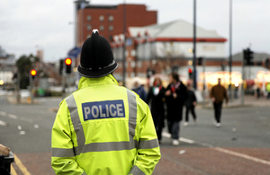 Police officer observing town centre