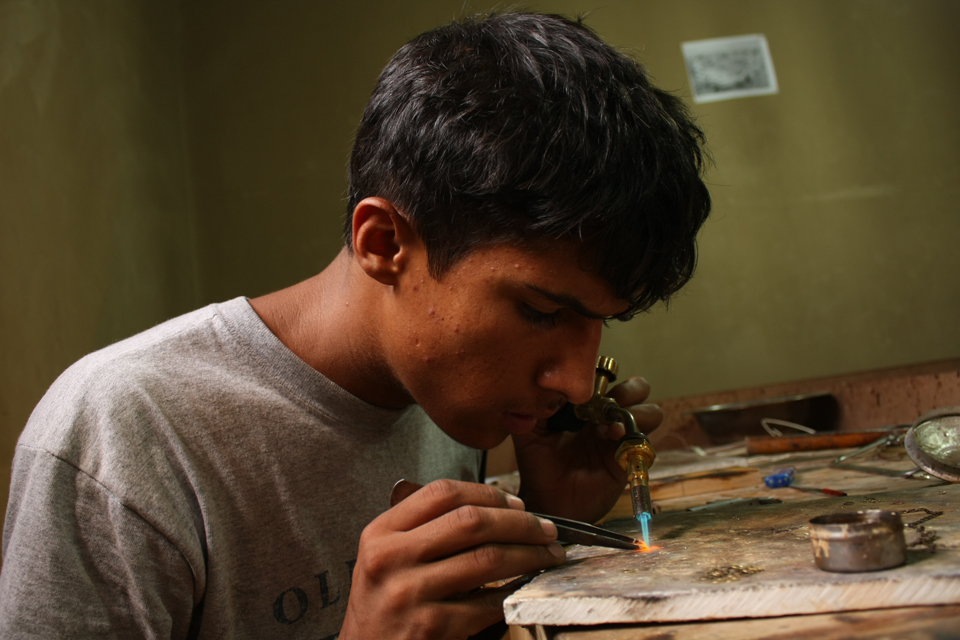 Mohammad at work in his workshop. Picture: Mohammad Humayoon Nawrozi/TMI