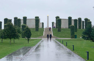 Two personnel climb steps at the National Memorial Arboretum in Staffordshire.