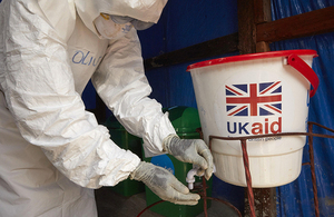 A member of an Ebola response team washes his hands a treatment centre. Credit: Unicef