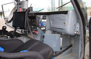 Interior view of prototype self-driving car, showing dashboard systems