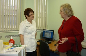 Baroness Hanham with a nurse in the blood testing unit