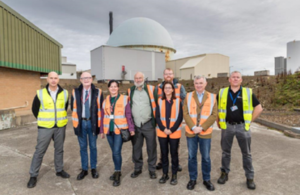 group of people standing at Dounreay site of Britain's former centre of nuclear fast reactor research and development is in the process of being demolished and cleaned up – radioactive waste was disposed there from 1959 until the late 1970s.