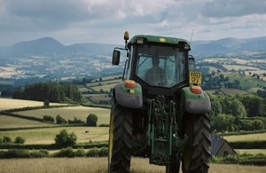 Tractor driving across a field
