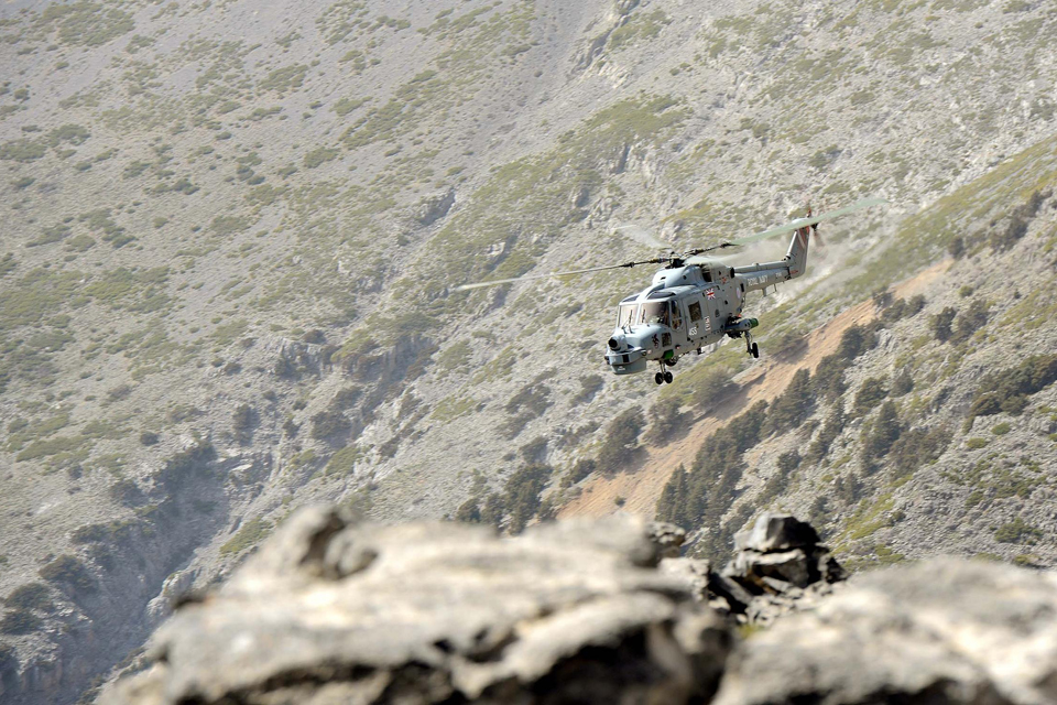 HMS Dragon's Lynx helicopter conducting mountain flying training