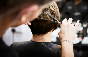 Hairdresser cutting a client's hair.